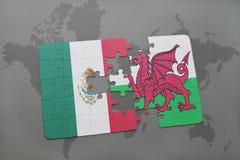 déconcertez avec le drapeau national du Mexique et du Pays de Galles sur un fond de carte du monde Image libre de droits