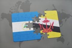 déconcertez avec le drapeau national du Nicaragua et du Brunei sur une carte du monde Image libre de droits