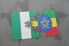 déconcertez avec le drapeau national du Nigéria et de l'Ethiopie sur une carte du monde Photos stock