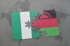 déconcertez avec le drapeau national du Nigéria et du Malawi sur une carte du monde Images stock