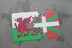 déconcertez avec le drapeau national du Pays de Galles et du pays Basque sur un fond de carte du monde Images stock