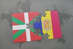 déconcertez avec le drapeau national du pays et de l'Andorre Basques sur un fond de carte du monde Photographie stock