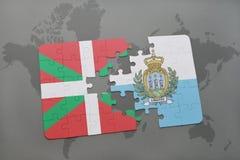 déconcertez avec le drapeau national du pays et du Saint-Marin Basques sur un fond de carte du monde Images stock
