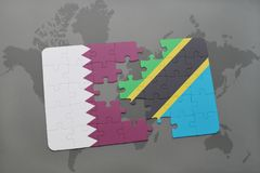 déconcertez avec le drapeau national du Qatar et de la Tanzanie sur un fond de carte du monde Images stock