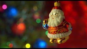 Décor de jouet de Santa de Noël avec l'arbre de nouvelle année banque de vidéos
