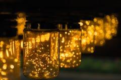 Décor léger de lampe dans le jour de Noël sur le fond de bokeh Photos libres de droits