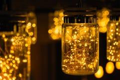 Décor léger de lampe dans le jour de Noël sur le fond de bokeh Photos stock