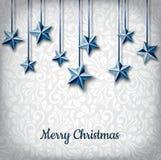 Décoration accrochante d'étoile bleue pour des vacances de Noël Photo libre de droits
