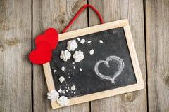 Décoration d'amour et de Valentine Day avec les coeurs et le cadre Images stock