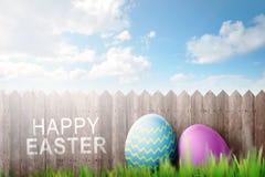 Décoration d'oeufs de pâques avec le texte heureux de Pâques Images stock