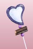 Décoration de coeur sur le fond rose Photos libres de droits