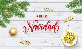 Décoration de Feliz Navidad Spanish Merry Christmas et police d'or de calligraphie sur le fond en bois blanc pour la carte de voe illustration libre de droits