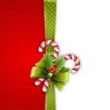 Décoration de Noël avec les feuilles et la sucrerie de houx Images libres de droits