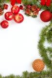 Décoration de Noël avec les ornamentals rouges et le sapin vert t de pommes Photos libres de droits
