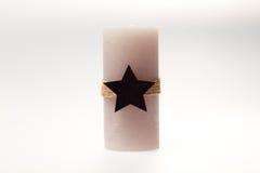 Décoration de Noël Bougie avec une corde et une étoile Photographie stock libre de droits