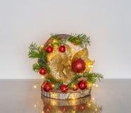 Décoration de Noël sur un morceau de bois Photo stock