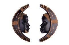Décoration en bois africaine de mur d'homme et de femme Images libres de droits