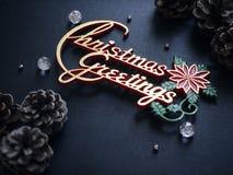 Décoration noire de vacances de Noël de fond de salutations de Noël Photographie stock