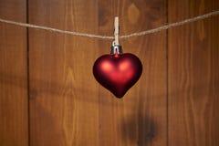 Décoration rouge de coeur de jour de valentines Photos stock
