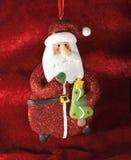 Décoration s'arrêtante du père noël de Noël contre r Photographie stock libre de droits