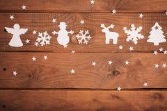Décorations de cartes de Joyeux Noël dans le style de papier de coupe Photographie stock