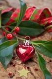 Décorations de Noël et branches de houx Photographie stock