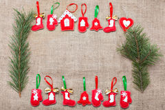 Décorations de Noël sur une toile de jute Images stock