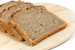 Découpé en tranches frais, part de pain-pain Photos stock