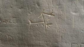 Découpages indigènes à l'écriture sur le parc historique en pierre Photographie stock
