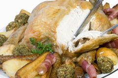 Découpant le poulet rôti, Photographie stock