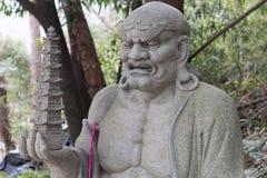 Découper-grande statue dix-huit en pierre vénérable photographie stock