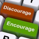 Découragez ou encouragez les clés à motiver ou décourager images stock