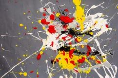 Défaut multicolore de flaque de couleur sur le fond gris photographie stock