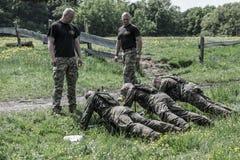 Défi d'élite - entraînement militaire, civils de concours Photos stock