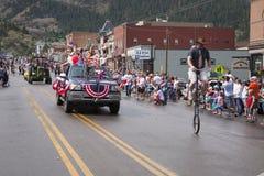 Défilé allant à vélo de Jour de la Déclaration d'Indépendance du 4 juillet Image stock