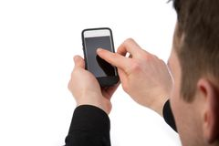 Défilement à un téléphone Images libres de droits