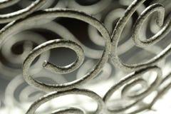 Défilements abstraits en métal avec des ombres Photographie stock libre de droits