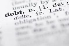 Définition de dette en dictionnaire anglais. Photo libre de droits