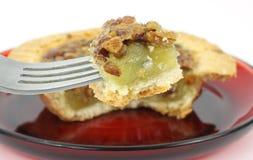 Dégagement de secteur de noix de pécan sur la fourchette. image libre de droits