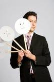 Déguisement : Masque fâché de Peeking Out From d'homme d'affaires photos stock