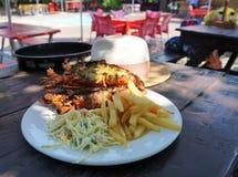 Déjeuner de homard sur la plage images libres de droits