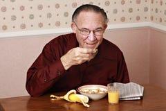 Déjeuner mangeur d'hommes mûr Photo stock