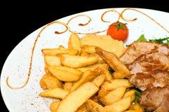 Déjeuner (porc et pomme de terre) Images libres de droits