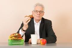 Déjeuner sain mangeur d'hommes d'affaires supérieures Image libre de droits