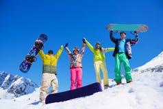 Démons avec le surf des neiges en montagnes Photos stock