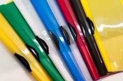 Dépliants colorés de PVC Photographie stock libre de droits
