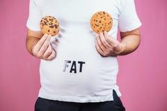 Déséquilibre hormonal, mangeant avec excès, dépendance de sucre image stock