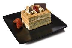 Désert de gâteau de caramel, de fraise et de chocolat Photographie stock