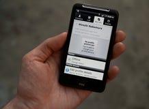 Désir HD de la prise HTC de main avec le profil de Skype photographie stock libre de droits