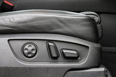 Détail d'ajustement de siège de voiture électrique Photographie stock libre de droits